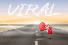 Viral against road leading out to the horizon Stock Photo