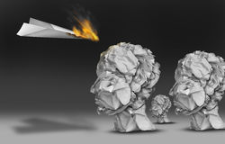 Viral Communication. Marketing and propaganda concept as a paper plane burning in flames as an audience group of human heads made of crumpled office papers Royalty Free Stock Images