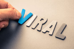 Viral. Hand arrange wood letters as Viral word Royalty Free Stock Photo