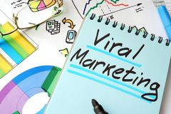 Viral Marketing written on a notepad. Viral Marketing written on a notepad sheet Royalty Free Stock Images