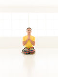 Virasana yoga gym Stock Image