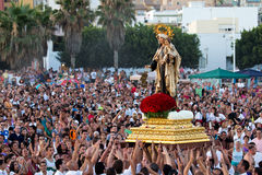 Virgen del Carmen. MALAGA, SPAIN - JULY 16: Unidentified local worshippers lift a religious image during the 'Virgen del Carmen' festival on July 16, 2011 in Royalty Free Stock Image
