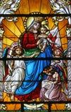 Virgen María con el bebé Jesús y ángeles Imagen de archivo libre de regalías