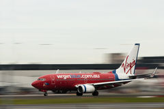 Virgin Airlines jet aircraft in motion. Royalty Free Stock Photography