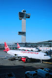 Virgin America plane and Air Traffic Control Tower at John F Kennedy International Airport. NEW YORK- JANUARY 21, 2016: Virgin America plane and Air Traffic Royalty Free Stock Photos