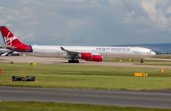 Virgin Atlantic A340 Imagens de Stock Royalty Free