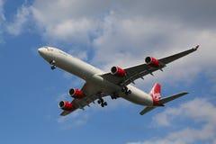Virgin Atlantic Airbus A340 descending for landing at JFK International Airport in New York. NEW YORK - AUGUST 13, 2015: Virgin Atlantic Airbus A340 descending Stock Images