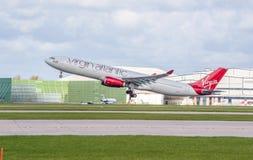 Virgin Atlantic Airbus A330 just taken off. MANCHESTER, UNITED KINGDOM - APRIL 11, 2015: Airbus A330 Virgin Atlantic just taken off from Manchester airport on stock photos