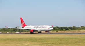 Virgin Atlantic Airbus A330-200 just after touching down at Manchester Airport. MANCHESTER AIRPORT - JULY 4th 2018: Virgin Atlantic Airbus A330-200 just after stock photo