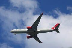 Virgin Atlantic Airbus A330 in New York sky before landing at JFK Airport. Royalty Free Stock Images