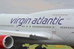 Virgin atlantic Boeing 747 - 400. Close up view of a Virgin Atlantic Boeing 747 - 400 aircraft logo / brand, at Manchester airport, UK Royalty Free Stock Photo