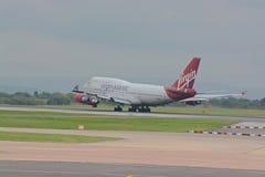 Virgin atlantic 747 - 400. A Virgin atlantic Boeing 747 - 400 taking off at Manchester airport, UK Stock Photos