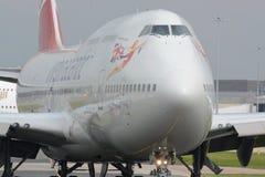 Virgin atlantic 747 - 400. A Virgin atlantic Boeing 747 - 400 taxiing for departure at Manchester airport, UK Royalty Free Stock Photos