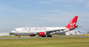 Virgin Atlantic A330-200 `Honkytonk Woman` starting to take off at Manchester Airport. MANCHESTER AIRPORT - MAY 15th 2018: Virgin Atlantic A330-200 `Honkytonk royalty free stock photos