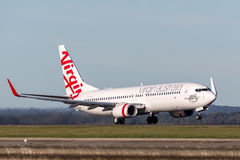 Virgin Australia Airlines Boeing 737-800 aircraft taking off from Sydney Airport. Stock Photo