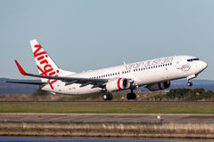 Virgin Australia Airlines Boeing 737-800 aircraft taking off from Sydney Airport. Sydney, Australia - May 5, 2014: Virgin Australia Airlines Boeing 737-800 stock image