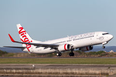 Virgin Australia Airlines Boeing 737-800 aircraft taking off from Sydney Airport. Royalty Free Stock Image