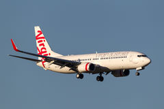 Virgin Australia Airlines Boeing 737-8FE VH-YFF on approach to land at Melbourne International Airport. Melbourne, Australia - September 25, 2011: Virgin Royalty Free Stock Photography