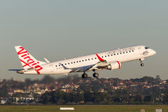 Virgin Australia Embraer regional jet ERJ-190 taking off from Sydney Airport. Sydney, Australia - May 5, 2014: Virgin Australia Embraer regional jet ERJ-190 royalty free stock images