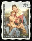 Virgin with Child by Joseph von Fuhrich. Upper Volta - stamp 1973: Edition on Biblical motifs, shows Painting Virgin with Child by Joseph von Fuhrich Stock Photography