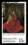 Virgin and Child, painting by Jan van Eyck. Australia - circa 1978: A stamp printed in Australia shows painting by Jan van Eyck, `The Virgin and Child `, series stock photo