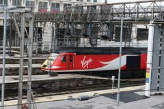 Virgin East Coast liveried hst train Kings Cross. Power car number 43251 in Virgin East Coast livery at the front of a train entering Kings Cross railway station Stock Photos
