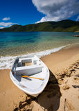 Virgin Gorda Explorations. Small boat on the shore of a tropical island Royalty Free Stock Images