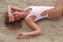Virgin Islands Caribbean Beach Girl. Bikini girl at the beach lying on the Caribbean sand stock image