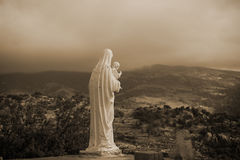 The Virgin & Jesus Statue Sepia. A back view of Virgin Mary holding Baby Jesus in sepia Royalty Free Stock Photography