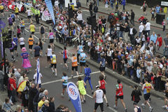 Virgin London Marathon 2010 from above. Virgin London Marathon 2010 - runners along the Embankment near the finish of the marathon. Photograph taken from above Stock Photography
