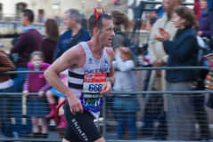 Virgin London Marathon 2012. Andy K Gore with 666 number, dressed as a devil Stock Images