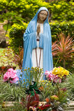 Virgin Mary. Colorful portuguese Virgin Mary statue in garden Stock Photo