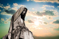 Virgin mary. Sculpture tombstone on blue sky Stock Photography
