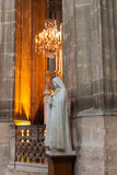 Virgin Mary. Old statue of Virgin Mary inside the Church in Paris, France Royalty Free Stock Photography