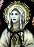 Virgin Mary. A stained glass window of Blessed Virgin Mary Stock Photo
