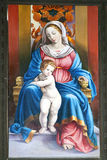 Virgin Mary with baby Jesus. Painting of the Virgin Mary with baby Jesus in a small mountain chapel Stock Photos