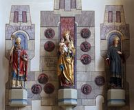 Virgin Mary with baby Jesus and Saints Magnus and Ulrich. The parish church of St. Peter and Paul in Oberstaufen, Germany Stock Photos