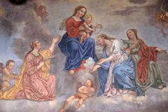 Virgin Mary with the baby Jesus surrounded by saints and angels Royalty Free Stock Photos