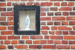 Virgin Mary and brick wall Royalty Free Stock Images