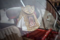 Virgin Mary in car. Vintage image stock photo