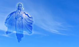 Virgin Mary with child Jesus over blue sky Royalty Free Stock Image