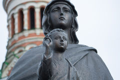 Virgin Mary with the Christ child. Photo Monument of the Virgin Mary with the Christ child in his arms in Yoshkar-Ola. The monument was erected in front of the Stock Photo
