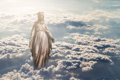 Virgin Mary in Clouds. Bronze sculpture of Holy Virgin Mary in clouds Stock Photos