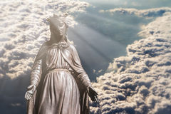 Virgin Mary in Clouds. Bronze sculpture of Holy Virgin Mary in clouds Stock Images