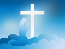 Virgin Mary at the Foot of the Cross in the Clouds Stock Photo