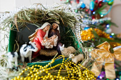 Virgin Mary gave birth to Jesus, and it lies in the crib Royalty Free Stock Photography