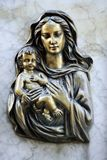 Virgin Mary and Jesus. Decoration on marble tomb ,Virgin Mary and little Jesus Royalty Free Stock Photo