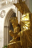Virgin Mary With Jesus. A golden statue of the Virgin Mary holding her son Jesus, located in a cathedral Royalty Free Stock Photography