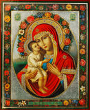 Virgin Mary and Jesus. Virgin Mary holding Jesus. Old decorated icon Royalty Free Stock Photo