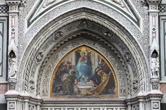 Virgin Mary mosaic. In central portal of Florence cathedral. Italy Stock Photo
